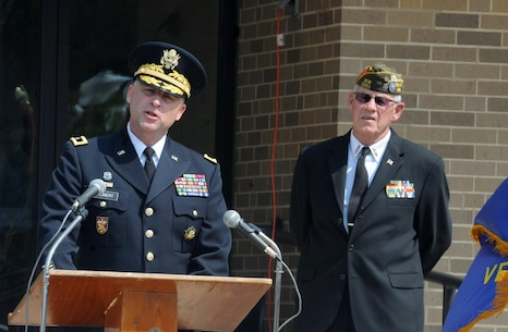 Major Gen. Patrick Reinert, the commanding general of the 88th Regional Support Command, speaks to the more than 200 people gathered at the Cherokee County, Iowa courthouse for a dedication ceremony for the Freedom Rock Tour that is in honor of the veterans of Cherokee County, September 10. Reinert is a native of Cherokee County, Iowa, and currently commands the 88th RSC, which provides base operations support for U.S. Army Reserve Soldiers, families and facilities across 19 states, of which Iowa is one.