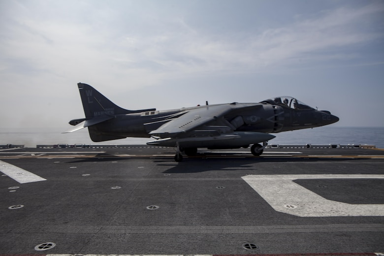 An AV-8B Harrier belonging to Marine Attack Squadron 311 prepares for flight aboard the USS Bonhomme Richard (LHD 6) while underway in the Pacific Ocean, June 9, 2017.