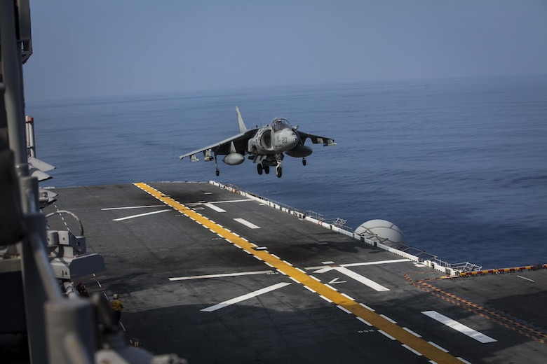A U.S. Marine Corps AV-8B Harrier aircraft belonging to Marine Attack Squadron (VMA) 311 prepares to land aboard the amphibious assault ship USS Bonhomme Richard (LHD 6) while underway in the Pacific Ocean, June 9, 2017.