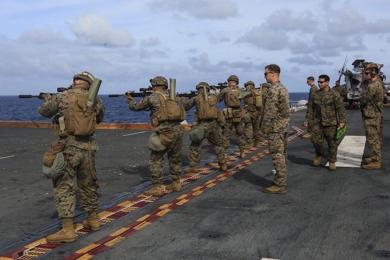 Marines with Kilo Company, Battalion Landing Team, 3rd Battalion, 5th Marines, 31st Marine Expeditionary Unit, fire M16A4 service rifles during combat conditioning marksmanship training aboard the USS Bonhomme Richard (LHD 6) while underway in the Pacific Ocean, June 24, 2017.