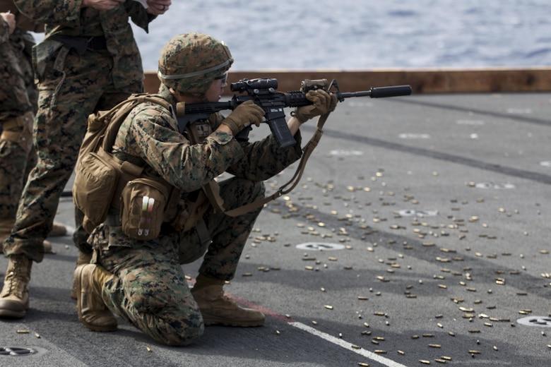 Lance Cpl. Joshua Lecleir, a rifleman with Kilo Company, Battalion Landing Team, 3rd Battalion, 5th Marines, 31st Marine Expeditionary Unit, fires an M16A4 service rifle during combat conditioning marksmanship training aboard the USS Bonhomme Richard (LHD 6) while underway in the Pacific Ocean, June 24, 2017.