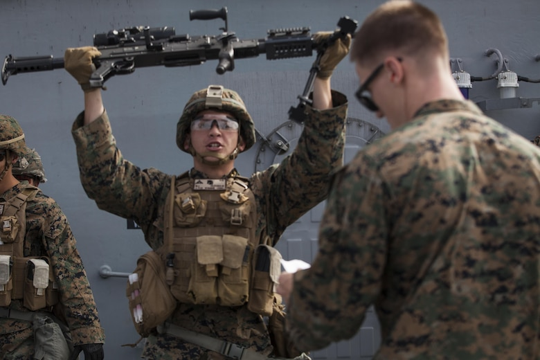 Lance Cpl. Joshua Lecleir, a rifleman with Kilo Company, Battalion Landing Team, 3rd Battalion, 5th Marines, 31st Marine Expeditionary Unit, conducts an exercise during combat conditioning marksmanship training aboard the USS Bonhomme Richard (LHD 6) while underway in the Pacific Ocean, June 24, 2017.