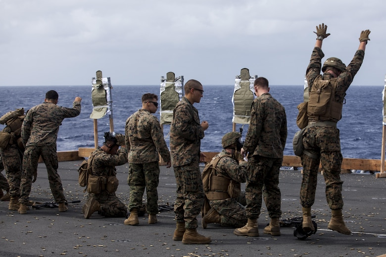 Marines with Battalion Landing Team, 3rd Battalion, 5th Marines, 31st Marine Expeditionary Unit, conduct exercises during combat conditioning marksmanship training aboard the USS Bonhomme Richard (LHD 6) while underway in the Pacific Ocean, June 24, 2017.