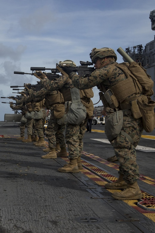 Marines with Kilo Company, Battalion Landing Team, 3rd Battalion, 5th Marines, conduct combat conditioning marksmanship training on the flight deck of the USS Bonhomme Richard (LHD 6) in the Pacific Ocean, June 24, 2017.