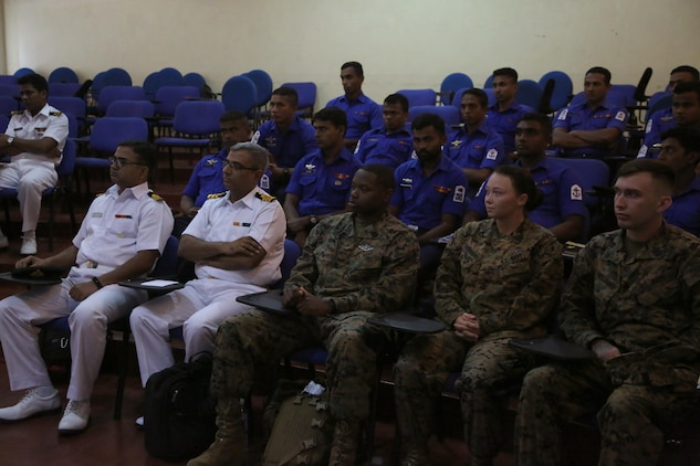 Members of the U.S. and Sri Lanka Navy came together for the opening ceremony of Sri Lanka Health Engagement 17 at Naval Base Welisara, Sri Lanka, Sept. 11, 2017. During SLHE-17, U.S. Navy Corpsmen will train members of the Sri Lanka Navy to conduct their own Combat Life Saver classes to further develop their medical capabilities. (U.S. Marine Corps photo by Sgt. Kathy Nunez)