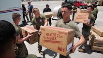 U.S. Marines with the 26th Marine Expeditionary Unit, unload emergency care items at the St. Thomas Cyril E. King Airport, U.S. Virgin Islands, Sept. 12, 2017.