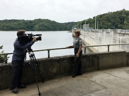 Paul Mojonnier, Tennessee Crossroads videographer, interviews Park Ranger Sondra Carmen Sept. 11, 2017 at Dale Hollow Dam in Celina, Tenn., for an upcoming episode in early 2018 for a feature as part of the dam's 75th anniversary, also in 2018. The program airs on Nashville Public Television. (USACE photo by Steve Crawford)