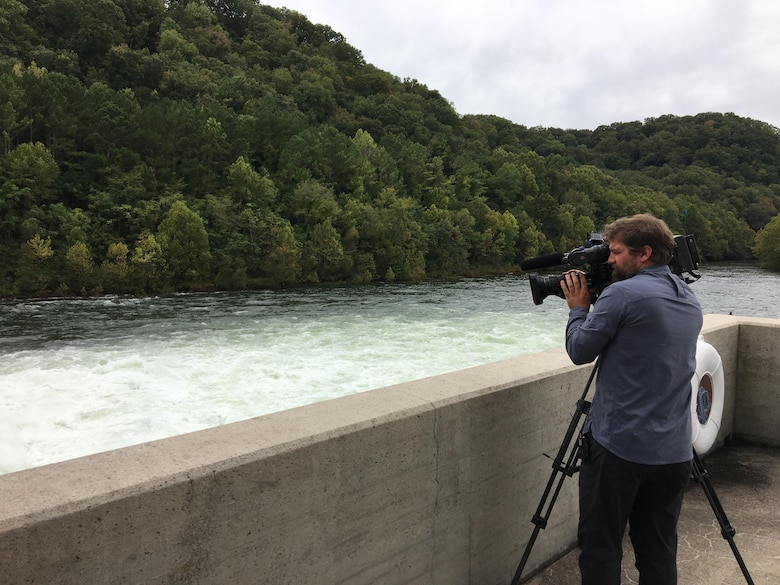 Paul Mojonnier, Tennessee Crossroads videographer, shoots footage Sept. 11, 2017 of Dale Hollow Dam's tailwater in Celina, Tenn., for an upcoming episode in early 2018 for a feature as part of the dam's 75th anniversary, also in 2018. The program airs on Nashville Public Television. (USACE photo by Sondra Carmen)