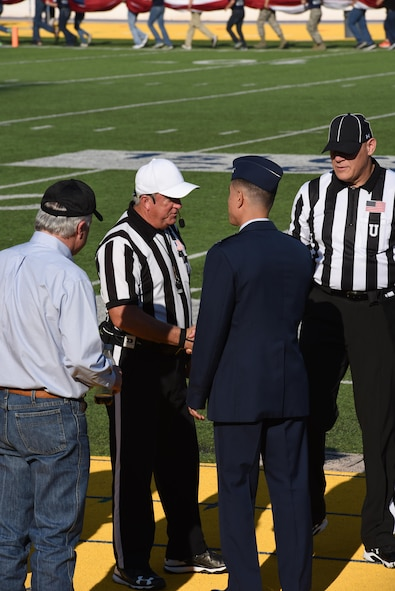 U.S Air Force Col. Ricky Mills, 17th Training Wing commander, greets the referees during the Military Appreciation Day game at Angelo State University's LeGrand Stadium in San Angelo, Texas, Sept. 9, 2017. The game was between ASU and Northern Michigan University and was a rematch of last year's ASU victory. (U.S. Air Force photo by Airman Zachary Chapman/Released)