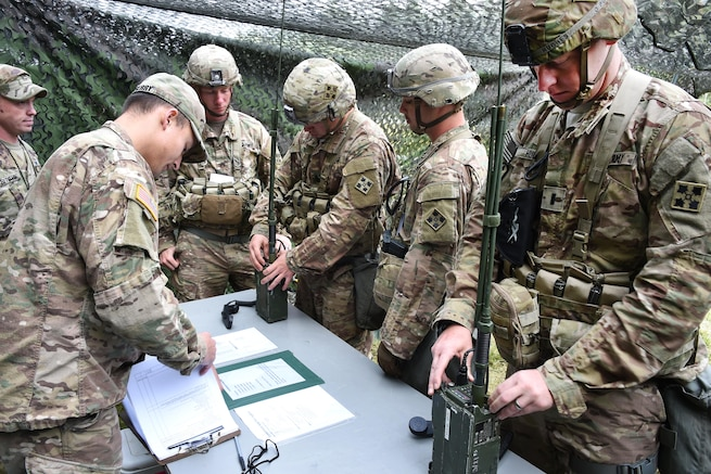 Soldiers put radios into operation during the Expert Infantryman Badge competition.