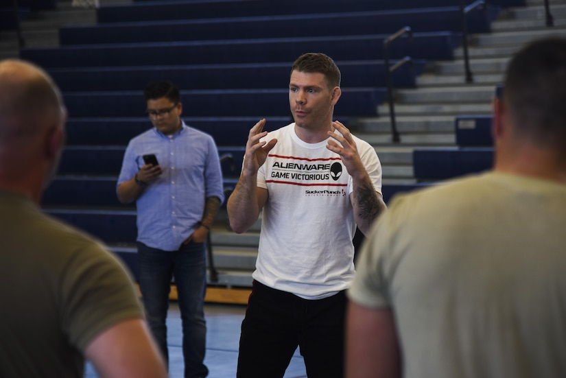 Paul Felder, Ultimate Fighting Championship lightweight division fighter, speaks to U.S. Army Soldiers about combative techniques at Joint Base Langley-Eustis, Va., Sep. 7, 2017.