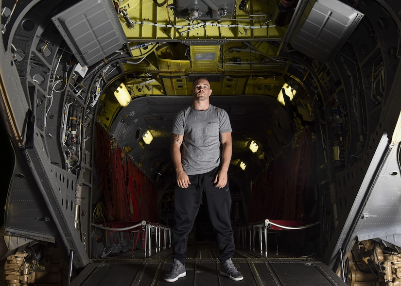 Colby Covington, Ultimate Fighting Championship welterweight division fighter, poses for a photo in the back of a CH-47 Chinook trainer at Joint Base Langley-Eustis, Va., Sep. 7, 2017.