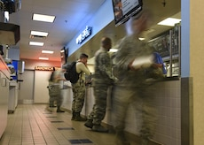 U.S. Air Force 1st Maintenance Squadron Airmen pick up their lunch at the Raptor Café at Joint Base Langley-Eustis, Va., Sept. 9, 2017.
