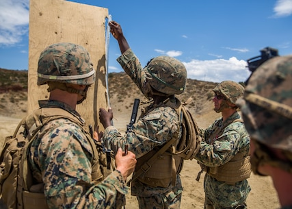 Combat engineers with Combat Service Support Company, I Marine Expeditionary Force Information Group, instruct Marines on how to set up a door breaching explosive charge at Camp Pendleton, Calif., Aug. 1, 2017. The Marines conducted the training to further develop their combat capabilities as part of the stand-up of the Marine Support Battalion. The mission of the new unit is to provide extensive logistical support to I MEF and I Marine Expeditionary Brigade command element, both in garrison and on deployment. Photo by Lance Cpl. Cutler Brice.