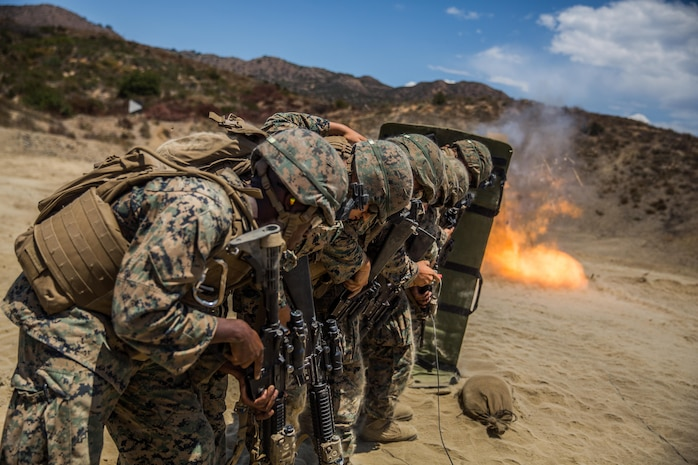 Marines with Combat Service Support Company, I Marine Expeditionary Force Information Group, line up behind a ballistic blanket before performing a simulated door breach at Camp Pendleton, Calif., Aug. 1, 2017. The Marines conducted the training to further develop their combat capabilities as part of the stand-up of the Marine Support Battalion. The mission of the new unit is to provide extensive logistical support to I MEF and I Marine Expeditionary Brigade command element, both in garrison and on deployment.