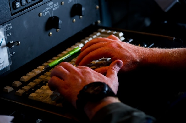 """Air Force Reserve 1st Lt. James Carpenter, aerial reconnaissance weather officer, 53rd Weather Reconnaissance Squadron, Keesler Air Force Base, Mississippi, enters data into his workstation on a WC-130J Super Hercules during a mission fly through the eye of Hurricane Irma Sep. 10, 2017. The Air Force Reserve 53rd Weather Reconnaissance Squadron """"Hurricane Hunters"""" fly WC-130J Super Hercules though the eye of active hurricanes to collect weather data using aircraft and externally dropped sensors to provide accurate weather data to the National Hurricane Center on approaching hurricanes. The Reserve Citizen Airmen provide 100 percent of the Air Force capability in low-level, real time data collection in Atlantic and Pacific Ocean tropical weather systems. (U.S. Air Force photo/Staff Sgt. Kyle Brasier)"""