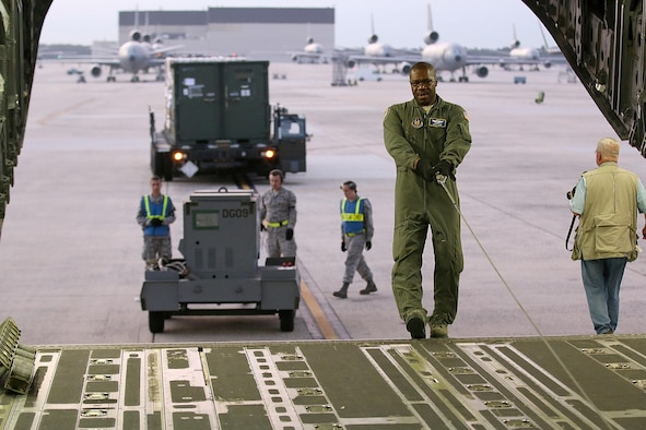 Master Sgt. Lorenzo Law, 89th Airlift Squadron loadmaster, prepares a 445th Airlift Wing C-17 Globemaster III on the ground at Joint Base McGuire-Dix-Lakehurst, New Jersey, for loading cargo and Airmen for transport to Tampa, Florida, to support Hurricane Irma relief efforts September 12, 2017