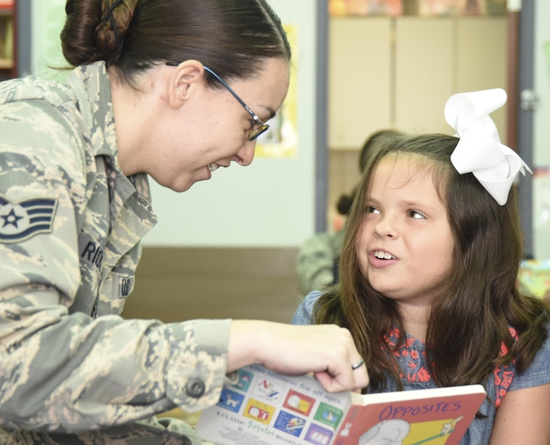 Staff Sgt. Kirsten Rios, 301st Medical Squadron, reads to a special needs student Aug. 23, 2017, at Lone Star Elementary School in Keller, Texas. Eight Reserve medical Airmen visited the school to connect and read to students as part their unit's community outreach program. (U.S. Air Force photo by Ms. Julie Briden-Garcia)