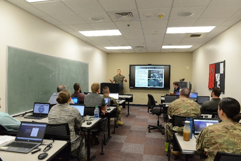 Intelligence analysts assigned to the 11th Special Operations Intelligence Squadron attend a data-tagging training event Aug. 24, 2017, at Hurlburt Field, Fla. Data-tagging is an artificial intelligence effort to assist with information gathering. (U.S. Air Force photo by Senior Airman Lynette M. Rolen)