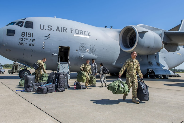 Airmen from Joint Base Charleston, South Carolina land at Scott Air Force Base, Illinois after evacuating in preparation for Hurricane Irma, Sept. 8, 2017.