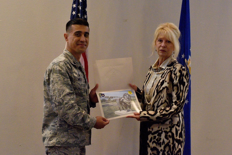 .S. Air Force Col. Ricky Mills, 17th Training Wing commander, presents an Honorary Commander certificate to Brenda Gunter, San Angelo mayor, at the Event Center on Goodfellow Air Force Base, Texas, Sept. 11, 2017. Mills selected Gunter as an Honorary Commander for her contributions to the base and community relations. (U.S. Air Force photo by Airman 1st Class Randall Moose/Released)