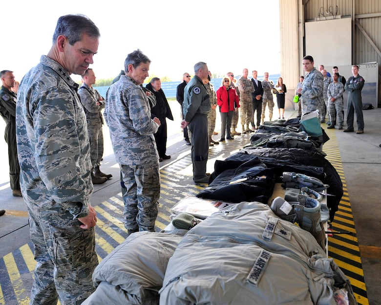 U.S. Air Force Lt. Gen. Kenneth Wilsbach, Alaskan Command commander, and U.S. Air Force Gen. Ellen Pawlikowski, Air Force Materiel Command commander, look at a cold weather gear display during an Arctic Security Expedition Sept. 8, 2017, at Eielson Air Force Base, Alaska. Air Force senior leaders from Headquarters Air Force and major commands visited Eielson AFB and other locations in Alaska to learn and discuss the challenges units face operating in the Arctic region and the affects climate change may have on their mission. (U.S. Air Force photo by Staff Sgt. Jerilyn Quintanilla)