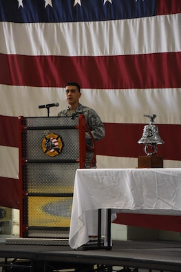 U.S. Air Force Col. Ricky Mills, 17th Training Wing commander, speaks at the 9/11 Memorial at the Louis F. Garland Department of Defense Fire Academy high bay on Goodfellow Air Force Base, Texas, Sept. 11, 2017. Mills spoke about how America is still healing after the events of 9/11. (U.S. Air Force photo by Airman Zachary Chapman/Released)