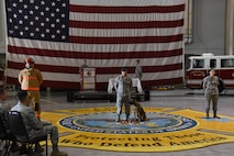 U.S. Air Force Tech. Sgt. Kyle Dobler, 312th Training Squadron instructor, speaks during the 9/11 Memorial at the Louis F. Garland Department of Defense Fire Academy high bay on Goodfellow Air Force Base, Texas, Sept. 11, 2017. Staff Sgt. Jonathan Kidd, 312th Training Squadron instructor, Senior Airmen Nicholas Suitonu, 17th Security Forces K-9 handler, and Senior Airmen Dalila Garcia, 17th Medical Operations Squadron Family Health medical technician, represented first responders who acted during the 9/11 terrorist attack. (U.S. Air Force photo by Airman Zachary Chapman/Released)