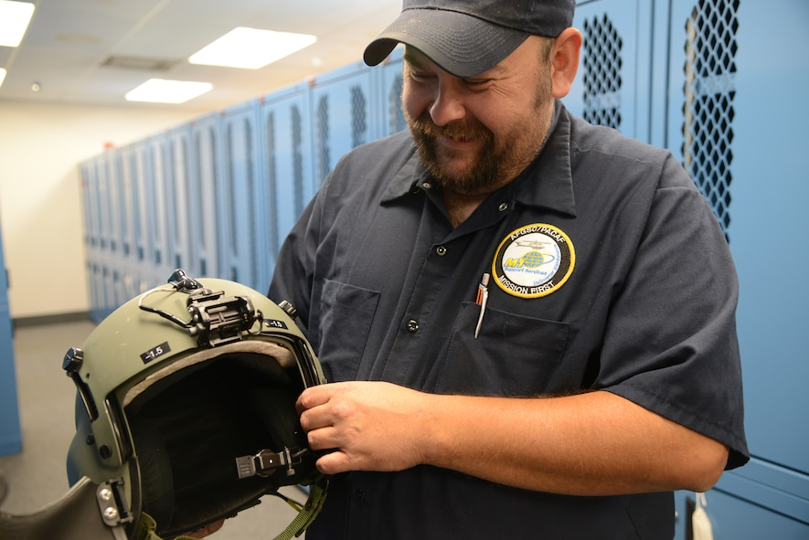 Sean Baker, aircrew flight equipment mechanic for M1 support services at the 40th Helicopter Squadron, shows one of the helmets he maintains and inspects Sept. 12, 2017, at Malmstrom Air Force Base, Mont.