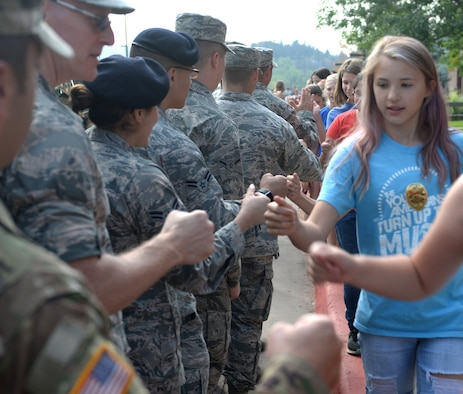 Students from Southwest Middle School and Corral Drive Elementary thank service members in Rapid City, S.D, Sept. 11, 2017. Black Hills area schools hosted various events in recognition of Patriot's Day to remember and honor the victims of the 9/11 terrorist attacks. (U.S. Air Force Photo by Airman 1st Class Thomas Karol)