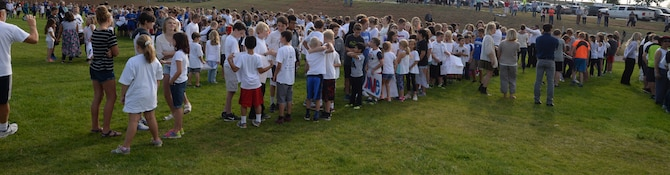 Students from Southwest Middle School and Corral Drive Elementary gather on the middle school's football field before Patriot's Day events in Rapid City S.D., Sept. 11, 2017. The students participated in the event, recited the Pledge of Allegiance, walked in a parade, and thanked local first responders and service members. (U.S. Air Force Photo by Airman 1st Class Thomas Karol)