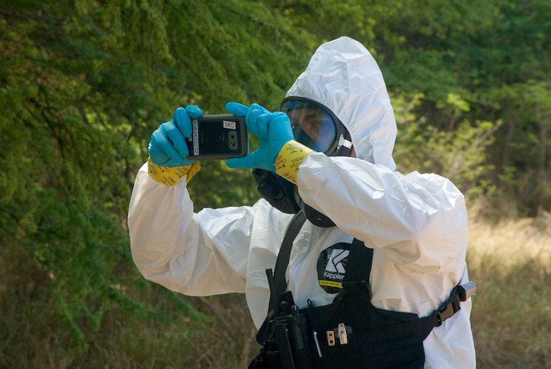 A Joint Hazard Assessment Team member from the 93rd Civil Support Team, Hawaii National Guard, takes a picture of a simulated hot zone as part of his hazmat survey