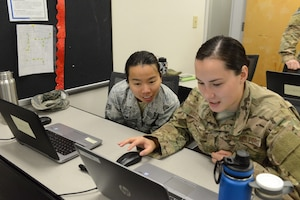 Staff Sgt. Ashlie Robledo and Senior Airman Thao Bui, 11th Special Operations Intelligence Squadron analysts, participate in a data-tagging training event Aug. 24, 2017, at Hurlburt Field, Fla. Data-tagging is designed to assist them with analyzing imagery. (U.S. Air Force photo by Senior Airman Lynette M. Rolen)