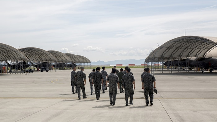 U.S. Marines with Marine Fighter Attack Squadron 121 lead a group of Japan Air Self-Defense Force personnel during an educational tour and class centered on the F-35B Lightning II at Marine Corps Air Station Iwakuni, Japan, Sept. 13, 2017.