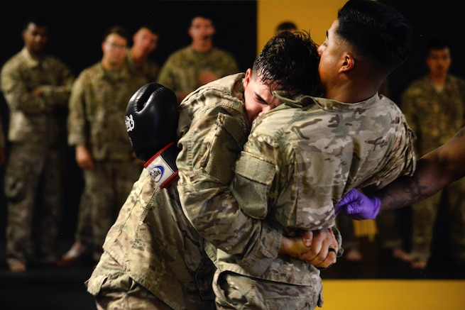 Soldiers conduct punching drills during a basic combatives course