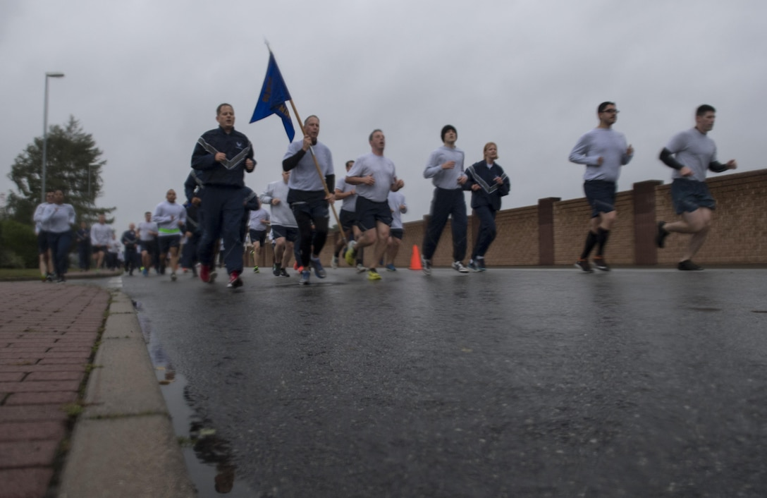 U.S. Airmen assigned to the 86th Airlift Wing, 521st Air Mobility Wing, and 435th Air Ground Operations Wing, participate in the Tri-Wing POW/MIA Memorial Run on Ramstein Air Base, Germany, Sept. 13, 2017. The run was approximately three miles and was held in honor of past and present prisoners of war and missing in action service members. (U.S. Air Force photo by Senior Airman Tryphena Mayhugh)