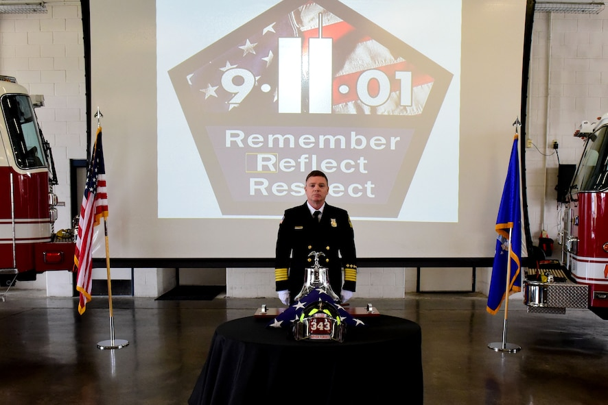 Sean Quinby, 4th Civil Engineer Squadron fire chief, rings a bell in honor of the fallen fire fighters during a 9/11 Remembrance Ceremony, Sept. 11, 2017, at Seymour Johnson Air Force Base, North Carolina. On Sept. 11, 2001, a total of 19 terrorists hijacked four commercial passenger jet airliners and took the lives of thousands of men, women, and children. (U.S. Air Force photo by Airman 1st Class Victoria Boyton)