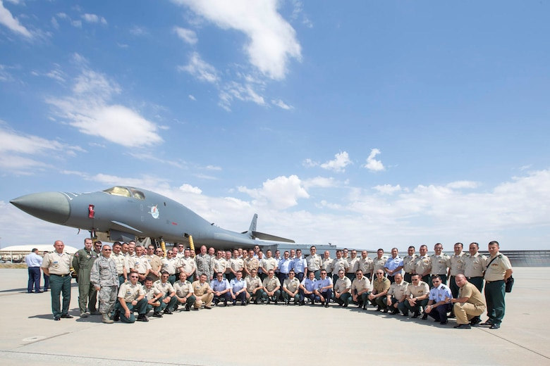 Members of the Republic of Colombia's military pose for a photo in front of a B-1B Lancer as part of their visit to Edwards Sept. 12. (U.S. Air Force photo by Christopher Okula)