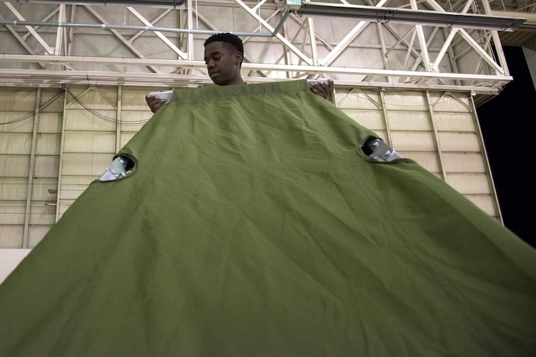 U.S. Army Pfc. Christopher Freeman, Georgia Army National Guard 781st Joint Task Force Chemical, Radiological, Nuclear, Explosive Response Package chemical specialist, assembles his cot, Sept. 12, 2017, at Moody Air Force Base, Ga. Units from the 48th Infantry Brigade Combat Team and JTF 781st CERFP stayed the night at Moody before heading to Orlando, Fla., to provide humanitarian relief for the victims of Hurricane Irma. (U.S. Air Force photo by Airman 1st Class Erick Requadt)