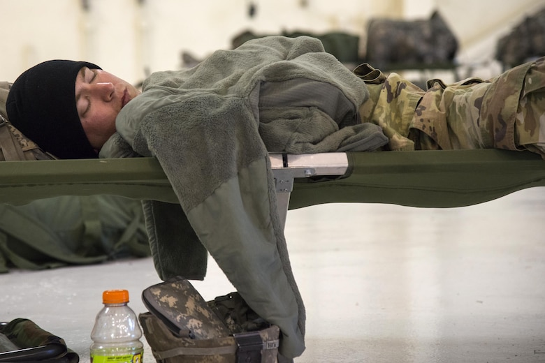 A Georgia Army National Guardsman rests, Sept. 13, 2017, at Moody Air Force Base, Ga. Units from the 48th Infantry Brigade Combat Team and Joint Task Force 781st Chemical, Radiological, Nuclear, Explosive Response Package stayed the night at Moody before heading to Orlando, Fla., to provide humanitarian relief for the victims of Hurricane Irma. (U.S. Air Force photo by Airman 1st Class Erick Requadt)