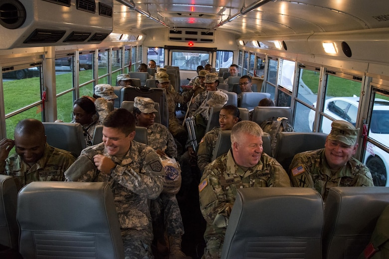 Georgia Army National Guardsmen await departure on a bus, Sept. 13, 2017, at Moody Air Force Base, Ga. Units from the 48th Infantry Brigade Combat Team and Joint Task Force 781st Chemical, Radiological, Nuclear, Explosive Response Package stayed the night at Moody before heading to Orlando, Fla., to provide humanitarian relief for the victims of Hurricane Irma. (U.S. Air Force photo by Airman 1st Class Erick Requadt)
