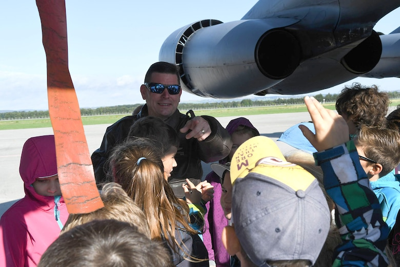 U.S. Air Force Lt. Col. Shawn Werchan, the 307th Operations Support Squadron commander, calls on a young student to answer a trivia question about the B-52 Stratofortress during a school tour at the Leoš Janáček Ostrava Airport, Czech Republic, Sept. 13, 2017.