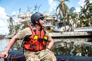 Sgt. Jonathan Mazella encounters a severely damaged neighborhood while conducting maritime rescue and reconnaissance operation