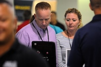 Staff Sgt. Mark Sobol, a pre-deployment attendee at the Yellow Ribbon event, uses ones of the devices at a community partner booth during a break between presentations in Minneapolis September 9.