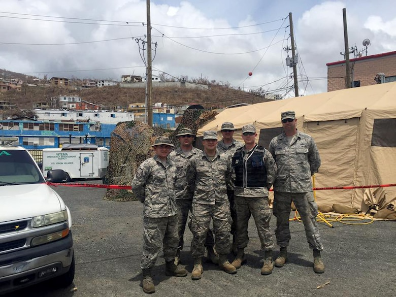 A six-Airman team from the 269th Combat Communications Squadron continues to provide tactical communications support to Hurricane Irma relief efforts in the U.S. Virgin Islands. The team, which consists of Back row (left to right) Tech. Sgt. Jason Clarkson, Tech. Sgt. Zachary Ruoff; Front row (left to right) Master Sgt. Nathan Lukey (123 ACS), Tech. Sgt. Michael Miller, Senior Airman Jade Brown and Capt. Craig Conner, is providing tactical communication support to first responders and others involved in Hurricane Irma relief efforts.(Courtesy photo)