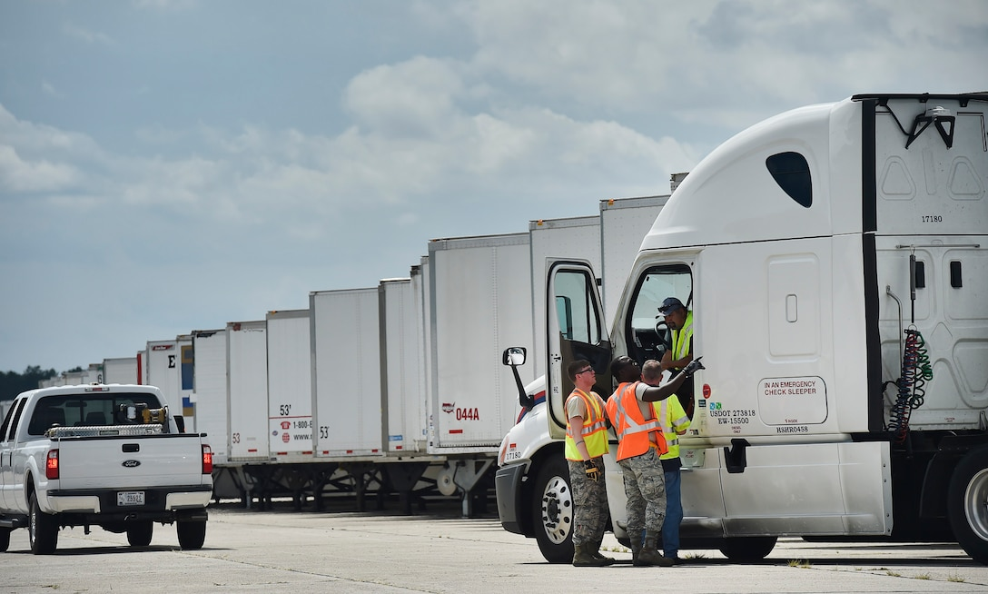 Airmen of the 43rd Air Mobility Operations Group, Pope Army Airfield, N.C., and the U.S. Department of Homeland Security - Federal Emergency Management Agency (FEMA), direct truck drivers transporting goods and commodities in support of Hurricane Irma relief efforts at Joint Base Charleston's North Auxiliary Airfield, S.C., Sept. 13, 2017. The airfield acts as a receiving and distribution staging area for goods and commodities to be transported to hurricane victims here and areas to the southeast over the next few weeks. Airmen of the 43rd AMOG and FEMA are working side-by-side executing relief efforts. (U.S. Air Force photo by Staff Sgt. Christopher Hubenthal)