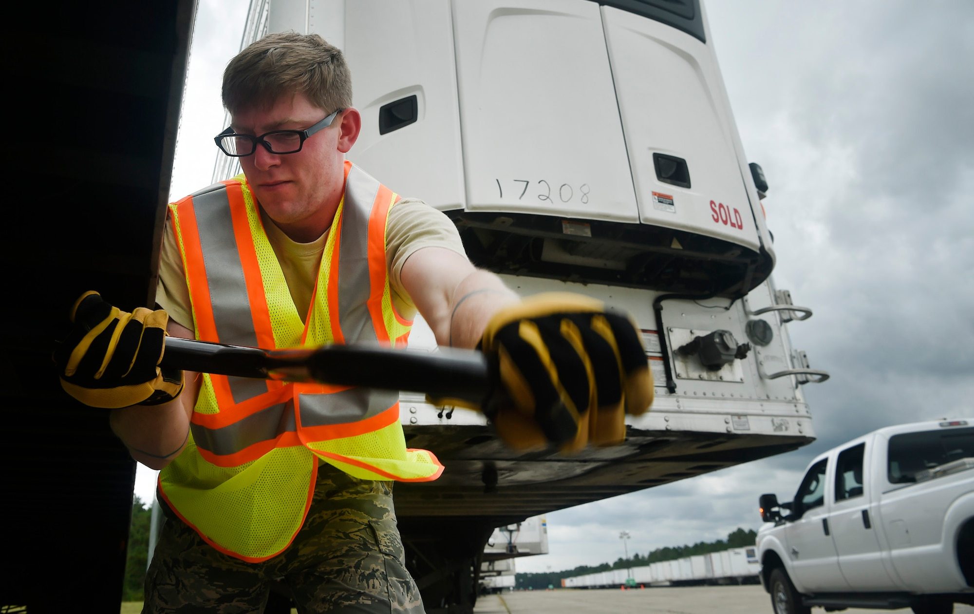 Staff Sgt. Donny Johnson, 43rd Air Mobility Squadron, Pope Air Force Base, N.C., helps disconnect a trailer from a truck transporting goods and commodities in support of Hurricane Irma relief efforts at Joint Base Charleston's North Auxiliary Airfield, S.C., Sept. 13, 2017. The airfield acts as a receiving and distribution staging area for goods and commodities being transported to hurricane victims here and areas to the southeast over the next few weeks. Airmen of the 43rd Air Mobility Operations Group and the U.S. Department of Homeland Security - Federal Emergency Management Agency (FEMA) are working side-by-side executing relief efforts. (U.S. Air Force photo by Staff Sgt. Christopher Hubenthal)