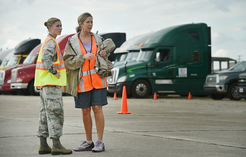 First Lt. Savannah Emmrich, left, 43rd Air Base Squadron fuels management officer in charge, Pope Army Airfield, N.C., speaks with Sonia Hancock, right, U.S. Department of Homeland Security - Federal Emergency Management Agency (FEMA) logistics specialist, at Joint Base Charleston's North Auxiliary Airfield, S.C., Sept. 13, 2017. The airfield acts as a receiving and distribution staging area for goods and commodities being transported to hurricane victims here and areas to the southeast over the next few weeks. Airmen of the 43rd Air Mobility Operations Group and FEMA are working side-by-side executing relief efforts. (U.S. Air Force photo by Staff Sgt. Christopher Hubenthal)