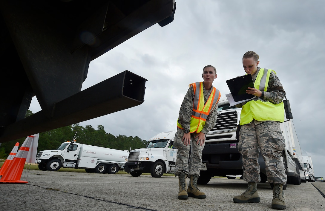First Lt. Savannah Emmrich, left, 43rd Air Base Squadron fuels management officer in charge, and Senior Airman Haley Bradshaw, right, 43rd ABS personnelist, both assigned to Pope Army Airfield, N.C., log information for a truck carrying goods prepped to support Hurricane Irma relief efforts at Joint Base Charleston's North Auxiliary Airfield, S.C., Sept. 13, 2017. The airfield acts as a receiving and distribution staging area for goods and commodities being transported to hurricane victims here and areas to the southeast over the next few weeks. Airmen of the 43rd Air Mobility Operations Group and U.S. Department of Homeland Security - Federal Emergency Management Agency (FEMA), are working side-by-side executing relief efforts. (U.S. Air Force photo by Staff Sgt. Christopher Hubenthal)
