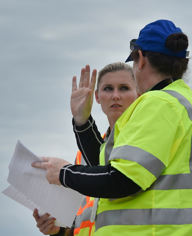 First Lt. Savannah Emmrich, 43rd Air Base Squadron fuels management officer in charge, Pope Army Airfield, N.C., speaks with Alice LaMere, U.S. Department of Homeland Security surge capacity force, at Joint Base Charleston's North Auxiliary Airfield, S.C., Sept. 13, 2017. The airfield acts as a receiving and distribution staging area for goods and commodities being transported to hurricane victims here and areas to the southeast over the next few weeks. Airmen of the 43rd Air Mobility Operations Group and U.S. Department of Homeland Security - Federal Emergency Management Agency (FEMA), are working side-by-side executing relief efforts. (U.S. Air Force photo by Staff Sgt. Christopher Hubenthal)